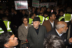 "Amid high security measures, hundreds of Kashmiri protesters, supported by George Galloway, demonstrate outside Wembley Stadium ahead of an address to more than 60,000 Indian expats by Prime Minister Narendra Modi at a 'UK Welcomes Modi' reception. Modi, a Hindu and his BJP party are accused of a wide range of human rights abuses against religious and ethnic minorities in India. PICTURED: George galloway makes his way through the boisterous crowd before delivering a speach criticising Cameron for allowing ""dictator"" Modi to come to London.6875."
