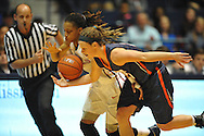 Mississippi Lady Rebels guard A'Queen Hayes (3), left, is fouled by Tennessee Martin Skyhawks guard Katie Schubert (20) in a WNIT game in Oxford Miss. on Wednesday, March 18, 2015. Ole Miss won 80-70. (AP Photo/Oxford Eagle, Bruce Newman)