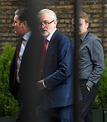 © Licensed to London News Pictures. 25/03/2019. London, UK. Labour Party leader JEREMY CORBYN is seen flanked by Shadow Brexit secretary KIER STARMER (left) and policy adviser ANDREW FISHER (right) at the Houses of Parliament, before a meeting with Prime Minster Theresa May. There have been reports of a cabinet revolt against Prime Minister Theresa May, over her handing of the Brexit negotiations.  Photo credit: Ben Cawthra/LNP