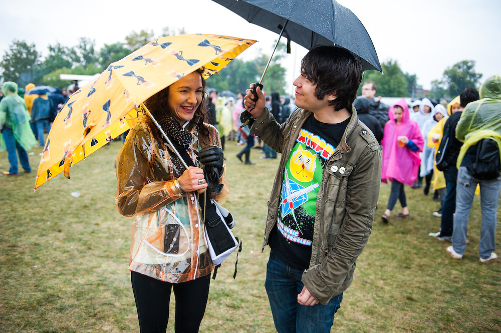 Riot Fest attendees try to stay dry on the third and final day of the festival on September 15, 2013.