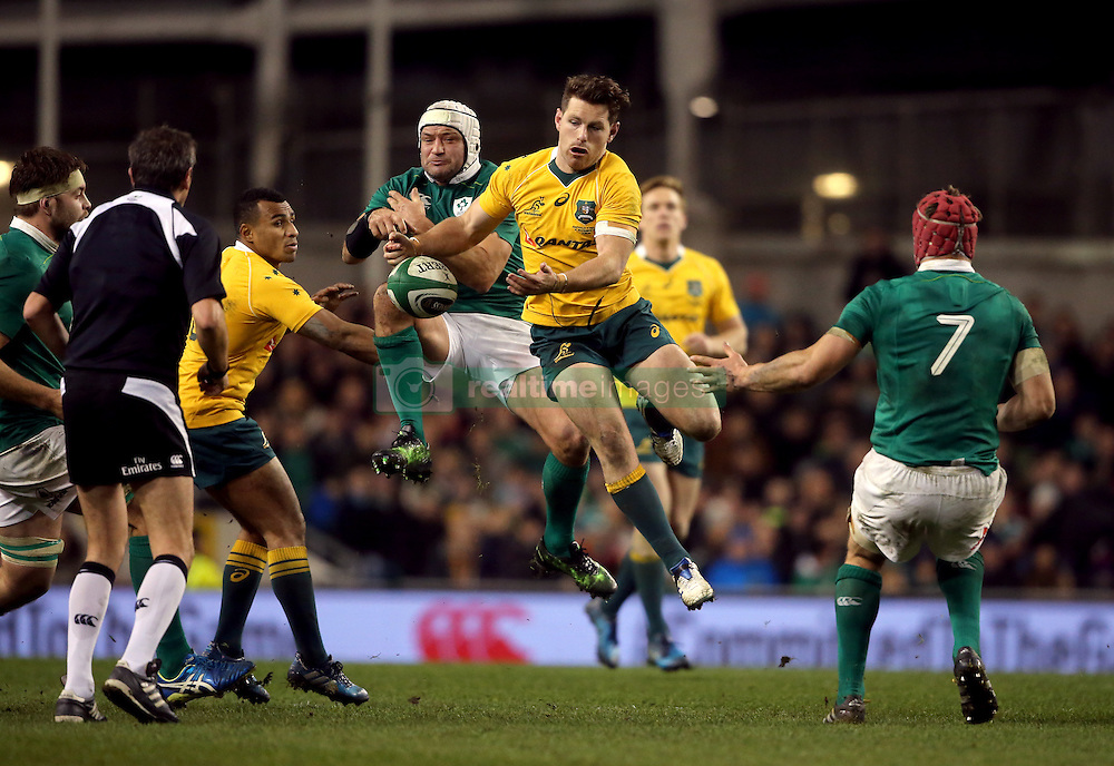 Ireland's Rory Best and Australia's Bernard Foley (right) compete for the ball during the Autumn International match at the Aviva Stadium, Dublin.