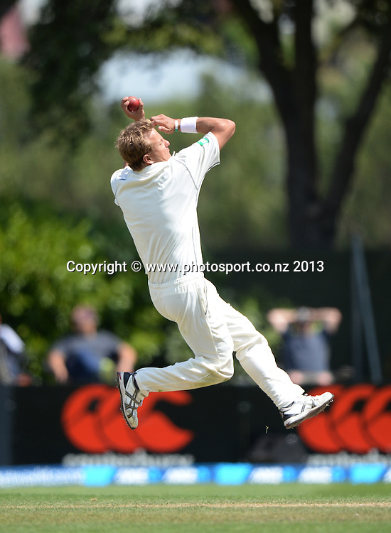 Neil Wagner bowling on Day 4 of the 1st cricket test match of the ANZ Test Series. New Zealand Black Caps v West Indies at University Oval in Dunedin. Friday 6 December 2013. Photo: Andrew Cornaga/www.Photosport.co.nz