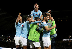 Manchester City's Ilkay Gundogan (right) celebrates scoring his side's third goal of the game with his team-mates during the Premier League match at the Etihad Stadium, Manchester.