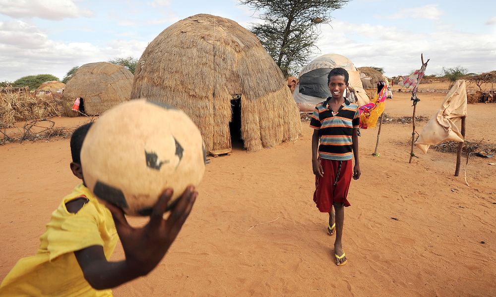 Idle Abdi Lahi (12) (holding ball) and Mohammed Nor Abdi at Belet Amin IDP (Internally Displaced People) camp, Somalia near the border with Kenya. The camp was set up for people fleeing the fighting in Somalia in 1997. 26/6/2008