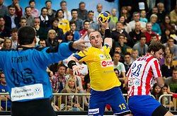 Milorad Krivokapic of Cimos Koper vs Arpad Sterbik of Atletico Madrid during 1st Leg handball match between RK Cimos Koper and BM Atletico Madrid (ESP) in Quarterfinals of EHF Champions League 2011/2012, on April 21, 2012 in Arena Bonifika, Koper, Slovenia. (Photo by Vid Ponikvar / Sportida.com)