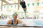 Concord's Ashley Schlock dives into the pool over Maddisen Lantz in the 200-yard freestyle relay at the girls swimming sectional finals Saturday, Feb. 7, 2015, at Northridge High School in Middlebury. Concord broke the meet and pool record in the event. Northridge won the title.