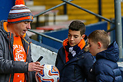 Luton fans look at a signed ball during the EFL Sky Bet League 1 match between Luton Town and Burton Albion at Kenilworth Road, Luton, England on 22 December 2018.