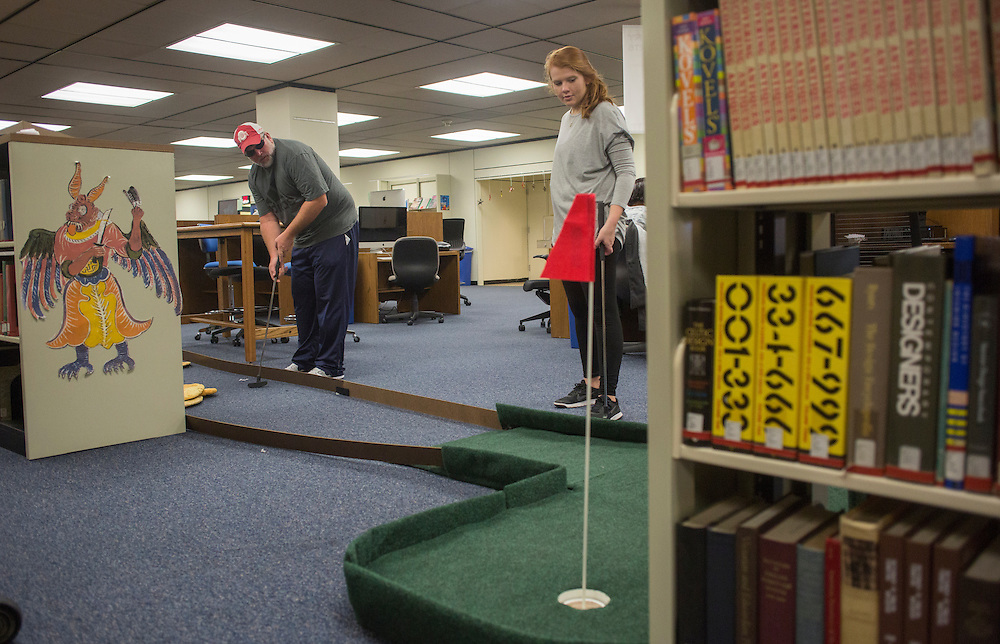 Tim Newberry, left, of Chillicothe, Ohio plays mini golf with his daughter Kate Newberry, a freshman, in Alden Library during Dad's Weekend on November 5, 2016.