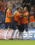 Picture by David Horn/Focus Images Ltd +44 7545 970036<br /> 23/07/2013<br /> Luton Town players celebrate with the scorer of their team's second goal of the game, Jake Howells (2nd right) during the Pre Season Friendly match at Kenilworth Road, Luton.