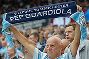 Manchester City football fan, football supporter, flag, the Premier League match between West Ham United and Manchester City at the London Stadium, London, England on 10 August 2019.