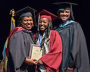 Paula Harris presents the Board Award to Deronisha Arceneaux during the Young Women's College Preparatory Academy graduation ceremony, May 31, 2015.
