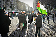 Frankfurt am Main | 16.12.2017<br /> <br /> On Saturday, December 16, 2017 about 1000 men, women and children take part in a demonstration march against the declaration of U.S. president Donald Trump to recognize Jerusalem as the capital of Israel and to relocate the U.S. Embassy in Israel from Tel Aviv to Jerusalem. The demonstration was registered under the slogan &quot;Demo f&uuml;r Jerusalem - Jerusalem/Alkudus ist die Hauptstadt Pal&auml;stinas&quot; (Demo for Jerusalem - Alkudus is the capital of Palestine).<br /> Here: A woman (female protester) is holding a flag of Palestine.<br /> <br /> photo &copy; peter-juelich.com<br /> <br /> - Foto honorarpflichtig<br /> - No Model Release<br /> - No Property Release