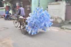 August 17, 2017 - Agartala, Tripura, India - A rickshaw driver transports used plastic bottles for recycling in Agartala, capital of the Northeastern state of Tripura. (Credit Image: © Abhisek Saha/Pacific Press via ZUMA Wire)
