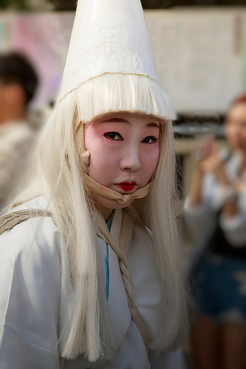 A costumed participant at a traditional Japanese festival.
