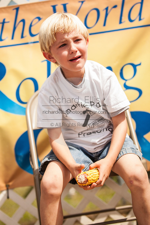 A young competitor tears up as he struggles to husk the most corn at the World Grits Festival April 14, 2012 in St. George, SC. The festival celebrates the southern love for the sticky corn porridge