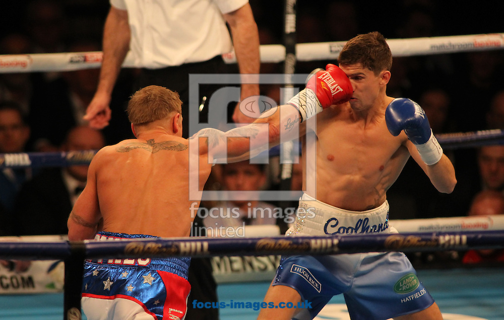 Luke Campbell (Light Blue Shorts ) and Gary Sykes (White/Blue/Red Shorts) during their Commonwealth Lightweight Championship bout at Sheffield Arena, Sheffield<br /> Picture by Stephen Gaunt/Focus Images Ltd +447904 833202<br /> 26/03/2016