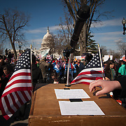 Remarks recognizing The United for Marriage:  Light the Way to Justice Coalition as well as chants of support for gay marriage are taped to a podium as thousands demonstrated outside the Supreme Court during the hearings on the Defense of Marriage Act (DOMA) on Wednesday, March 27, 2013.