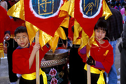 Two Children Holding Flags During Chinese New Year Celebration