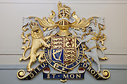 The Royal Coat of Arms that appears in all court rooms in England.