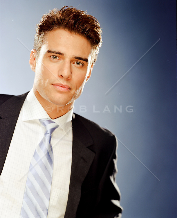 portrait of a handsome man in a jacket and tie