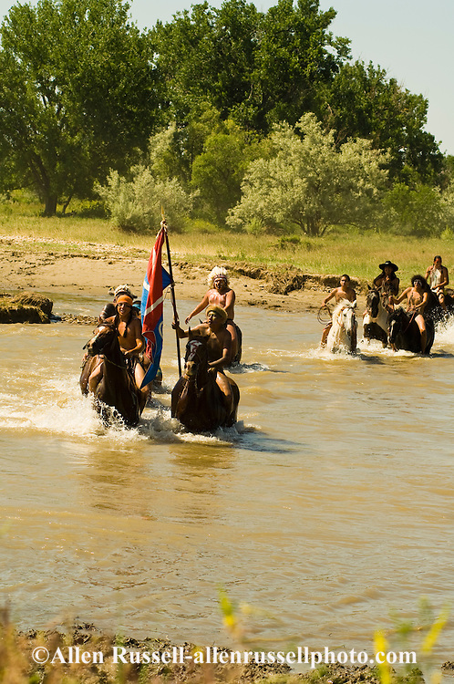 Custers Last Stand Reenactment on Little Bighorn River. Warriors with captured horses and flag after defeating Custer and 7th Cavalry. Real Bird Reenactment.