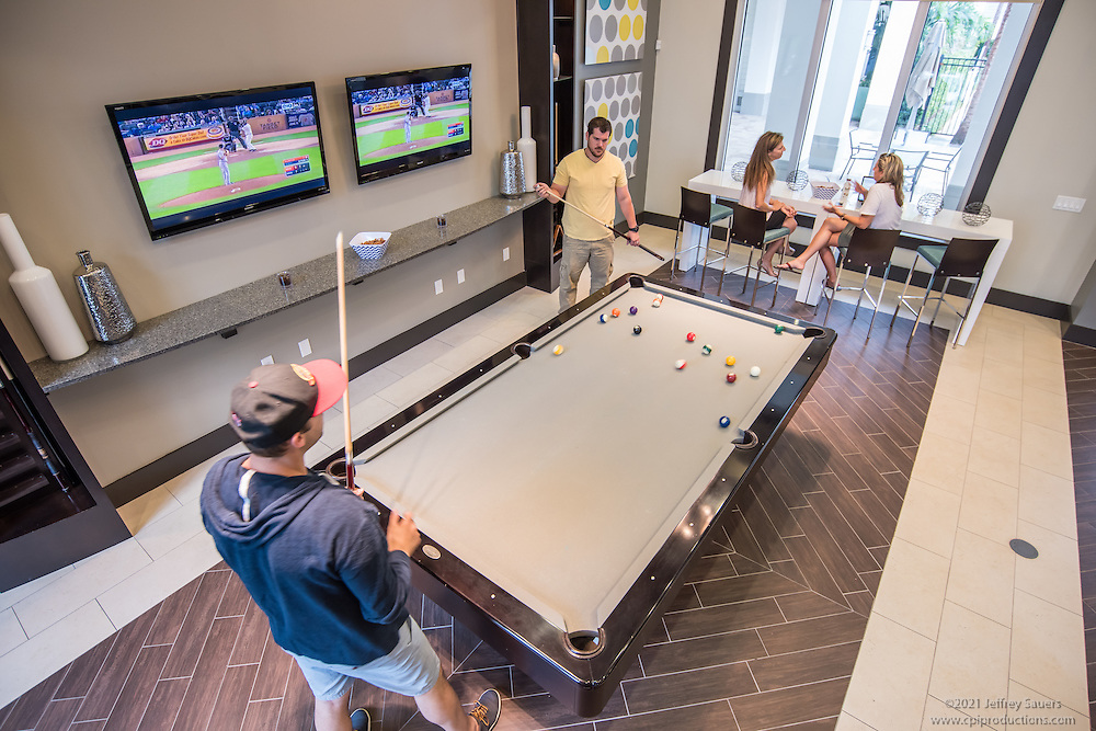 Lifestyle photo of playing pool at Epic at Gateway Centre in St. Petersburg Florida by Jeffrey Sauers of Commercial Photographics, Architectural Photo Artistry in Washington DC, Virginia to Florida and PA to New England
