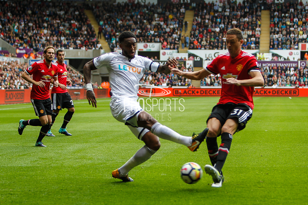 Leroy Fer of Swansea City and Nemanja Matic of Manchester United during the Premier League match between Swansea City and Manchester United at the Liberty Stadium, Swansea, Wales on 19 August 2017. Photo by Andrew Lewis.
