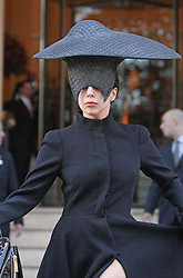 Pop star Lady Gaga leaving the Langham Hotel in central London, wearing a broad rim hat with a long black coat and over the knee black boots. UK. 30/10/2013<br />