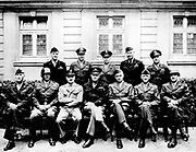 Senior American military officers during World War II. Seated (left to right) Generals William H. Simpson, George S. Patton, Carl A. Spaatz, Dwight D. Eisenhower, Omar Bradley, Courtney H. Hodges, and Leonard T. Gerow; standing (from left to right) Ralph
