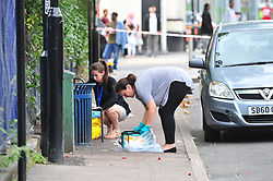 © Licensed to London News Pictures. 10/09/2018<br /> WOOLWICH, UK.<br /> Police officers removing first aid kit and cleaning area.<br /> A woman in her 20's has been stabbed in Anglesea Road,Woolwich.  The woman was taken to hospital by air ambulance.<br /> Photo credit: Grant Falvey/LNP