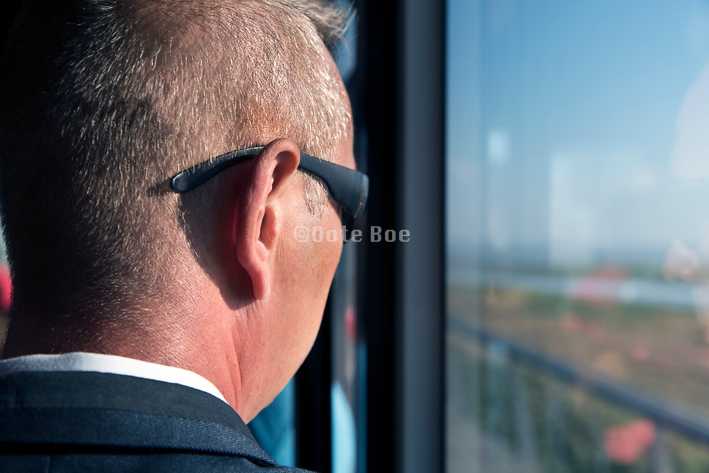 male person wearing sunglasses during early morning public bus commute