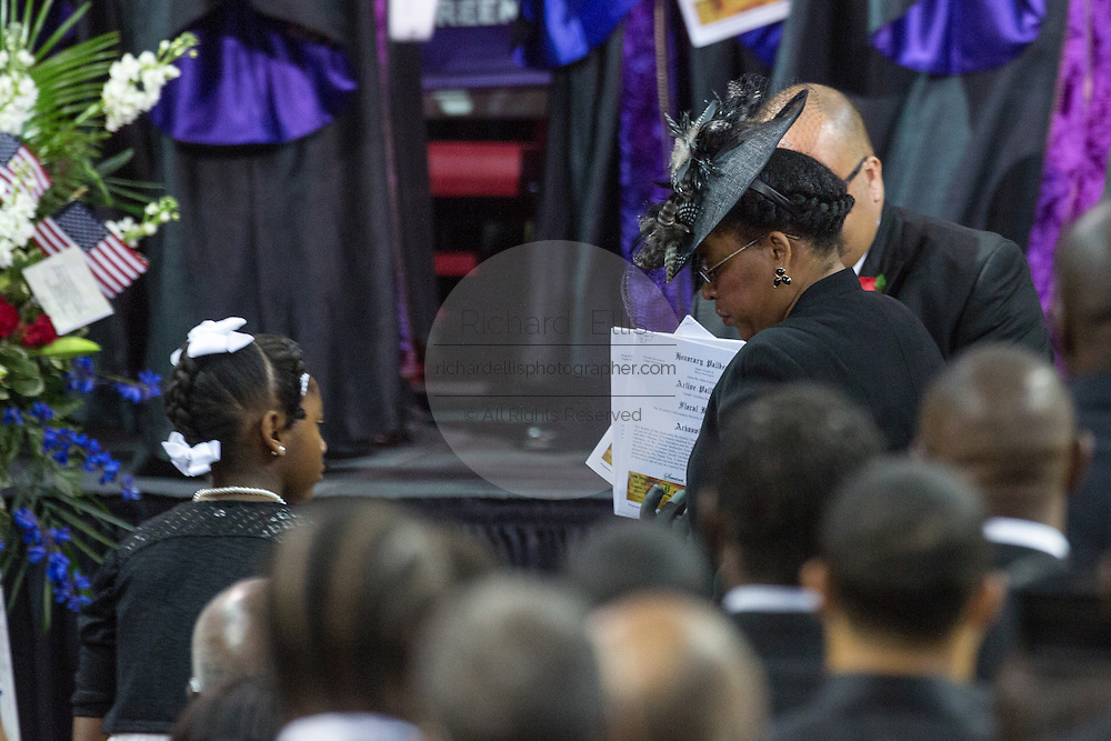Jennifer Pinckney, wife of slain State Senator Clementa Pinckney is escorted to her seat along with her daughters during the funeral service for slain State Senator Clementa Pinckney at the TD Arena June 24, 2015 in Charleston, South Carolina. Pinckney is one of the nine people killed in last weeks Charleston church massacre.