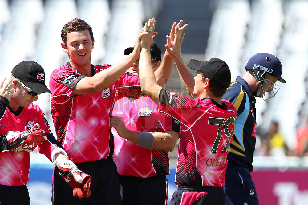 Josh Hazlewood celebrates the wicket of Andrew Gale ( C) during match 6 of the Karbonn Smart CLT20 South Africa between The Sydney Sixers and Yorkshire held at Newlands Stadium in Cape Town, South Africa on the 16th October 2012..Photo by Ron Gaunt/SPORTZPICS/CLT20