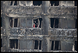 June 15, 2017 - London, United Kingdom - A fireman searching the burnt out shell of the Grenfell Tower  after the fire in west London. (Credit Image: © Stephen Lock/i-Images via ZUMA Press)