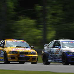May 23, 2009; Lakeville, CT, USA; Bill Auberlen follows the Kinetic Motorsports BMW M3 Coupe in his Turner Motorsport BMW M3 Coupe during qualifying for the Grand-Am Koni Sports Car Challenge series competition during the Memorial Day Road Racing Classic weekend at Lime Rock Park.