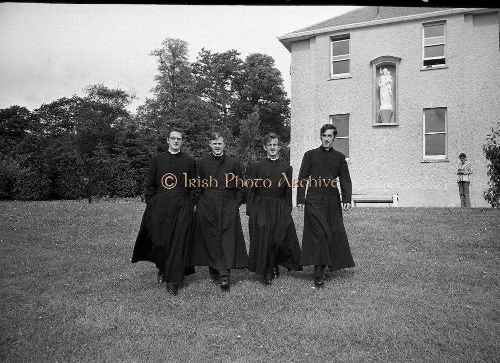 Christian Brothers .1972..11.08.1972..08.11.1972..11th August 1972..At St Marys,Christian Brothers College,Bray, the Christian Brothers prepare for their final profession before they move to the different provincial houses throughout the country...Under the statue of St Christopher four new brothers are starting out on their journey in life (L-R), Bro A Mc Alister,Belfast, Bro Paschal Walshe,Dundalk, Bro Hugh Moloney and Bro John McCourt,Dundalk..Bro Walshe will be leaving Ireland to teach in Mongu,Gambia,Africa.