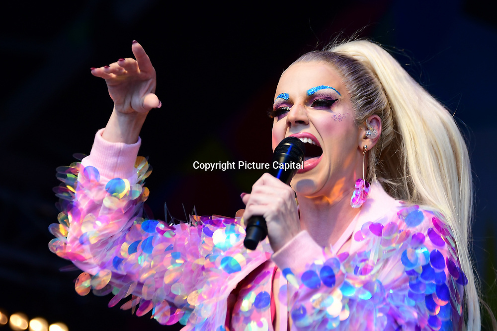 London, England, UK. 7th July 2018. Courtney Act performs at the Pride parade in Trafalgar Square, London, UK on 7th July 2018.