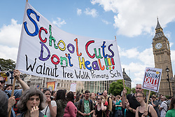© Licensed to London News Pictures. 05/07/2016. London, UK. Thousands of school teachers, parents and pupils protest in Parliament Square as teachers go on strike. The strike, called by the National Union of Teachers (NUT), is in response to cuts to funding and issues with workload, pay and other conditions. Photo credit: Rob Pinney/LNP
