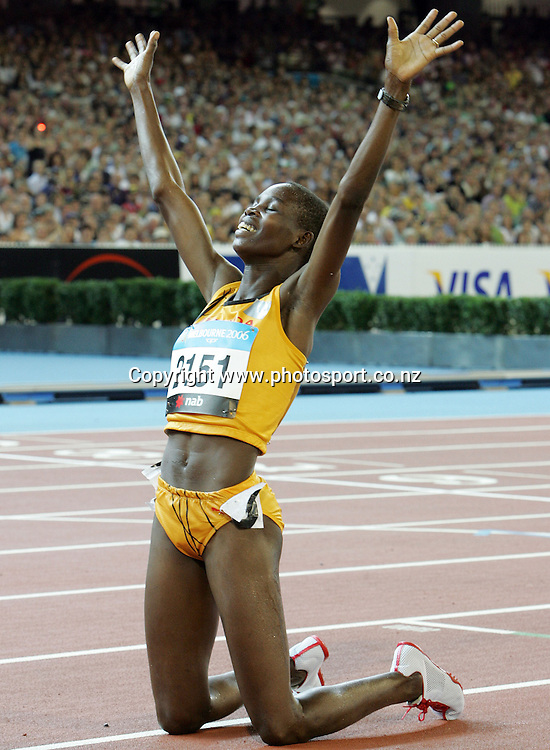 Dorcus Inzikuru (UGA) celebrates after winning the Women's 3000m Steeplechase on Day 7 of the XVIII Commonwealth Games at the MCG, Melbourne, Australia on Wednesday 22 March, 2006. Photo: Hannah Johnston/PHOTOSPORT