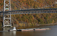 Fort Montgomery, NY - A tugboat pushes barges down the Hudson River by the Bear Mountain Bridge on Nov. 2, 2008.
