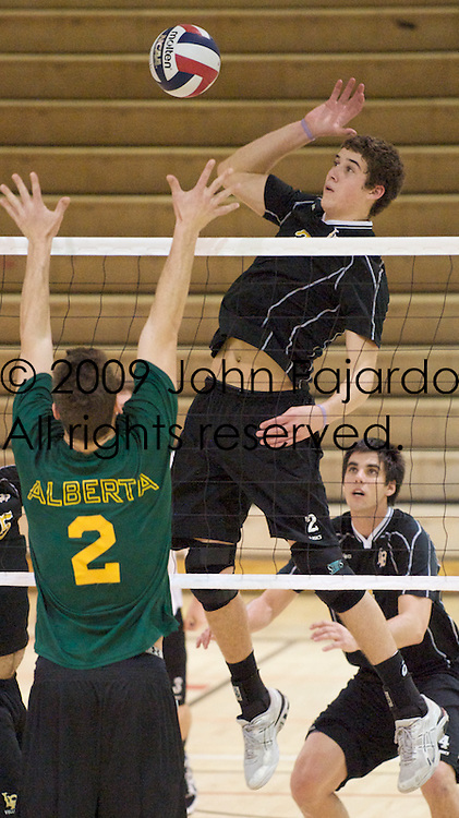 02Jan09 Long Beach, CA-  CSULB Middle Blocker Jim Baughman attempts to hit thru the block against University of Alberta.  CSULB lost the match in three straight sets.