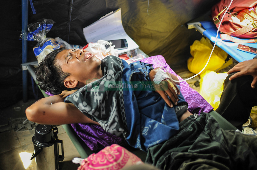 October 4, 2018 - Palu, Central Sulawesi, Indonesia - A resident seen receiving treatment at Anutapura Hospital after the earthquake. A deadly earthquake measuring 7.7 magnitude and the tsunami wave caused by it has destroyed the city of Palu and much of the area in Central Sulawesi. According to the officials, death toll from devastating quake and tsunami rises to 1,347, around 800 people in hospitals are seriously injured and some 62,000 people have been displaced in 24 camps around the region. (Credit Image: © Hariandi Hafid/SOPA Images via ZUMA Wire)