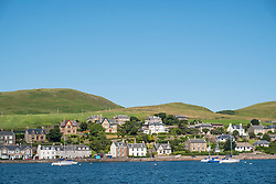 View of houses beside harbour at Campbeltown on Kintyre Peninsula in Argyll and Bute in Scotland United Kingdom