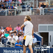 August 30, 2017 - New York, NY : Alexander Zverev, in white, reacts as he competes against Borna Coric, not visible, in the Grandstand on the third day of the U.S. Open, at the USTA Billie Jean King National Tennis Center in Queens, New York, on Wednesday. <br /> CREDIT : Karsten Moran for The New York Times