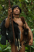 Huaorani Indian Oña Yate with bushmeat he hunt with his blowgun. Gabaro Community. Yasuni National Park.<br /> Amazon rainforest, ECUADOR.  South America<br /> He has a Woolly monkey, 2 trumpeters and 2 guans.<br /> This Indian tribe were basically uncontacted until 1956 when missionaries from the Summer Institute of Linguistics made contact with them. However there are still some groups from the tribe that remain uncontacted.  They are known as the Tagaeri & Taromenani. Traditionally these Indians were very hostile and killed many people who tried to enter into their territory. Their territory is in the Yasuni National Park which is now also being exploited for oil.