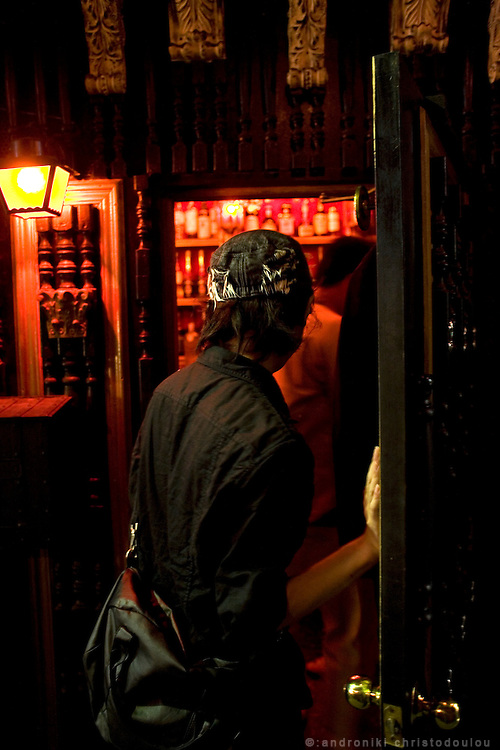 Client entering a bar on Nonbei street. Nonbei street in Shibuya is a narrow street with little restaurants and bars, each one with a special character. Tokyo 16 September 2008, Japan