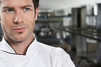 Male chef looking away close-up