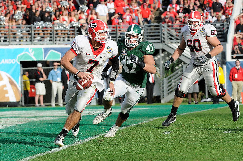 January 1, 2009: Matthew Stafford of the Georgia Bulldogs is persued by Brandon Long of the Michigan State Spartans during the NCAA football game between the Michigan State Spartans and the Georgia Bulldogs in the Capital One Bowl. The Bulldogs defeated the Spartans 24-12.