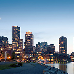 Finacial district and waterfront dusk skyline from Fan Pier, featuring Rowes Wharf and harbor, Boston, Massachusetts USA