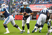 NASHVILLE, TN - NOVEMBER 29:  Marcus Mariota #8 of the Tennessee Titans turns to make a hand off during a game against the Oakland Raiders at Nissan Stadium on November 29, 2015 in Nashville, Tennessee.  The Raiders defeated the Titans 24-21.  (Photo by Wesley Hitt/Getty Images) *** Local Caption *** Marcus Mariota